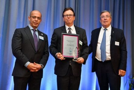 Rod Blackwell (centre) receiving the Excellence in Project Execution Award
